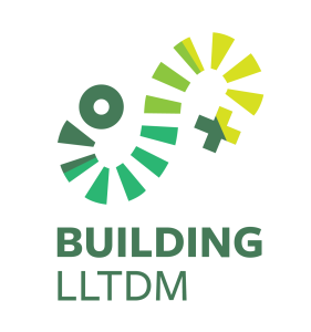 Green and yellow Building LLTDM blog logo, transitioning from circle to plus sign